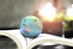 World globe on text book.     International education school Concept. Distance learning online education.  Stay home safe lives of Coronavirus or covid disease stop outbreak. 2019 nCov.