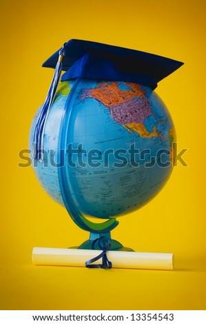 World globe with graduation cap and diploma