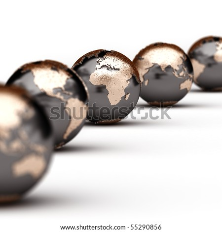 World globes showing different parts of the world with very shallow depth of field