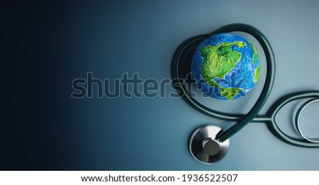 World Health Day. Global Health Awareness Concept. Handmade Globe inside Stethoscope as Heart Shape. Green Environment to Love and Care