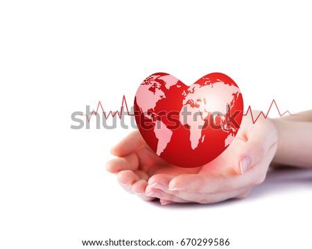 World heart day concept of young woman hand holding red heart with world map on white background #670299586