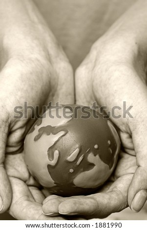 World in our hands in sepia