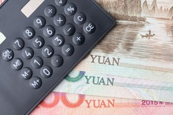 World influenced country, China financial economy, trade war or currency concept, black calculator on China yuan banknotes, tariff deal for major countries, emerging market.