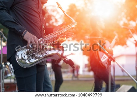 World Jazz festival. Saxophone, music instrument played by saxophonist player and band musicians on stage in fest. #1040499799