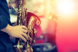 World Jazz festival. Saxophone, music instrument played by saxophonist player musician in fest.