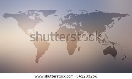 World map atlas against retro vintage blurred sky backgrounds.blurred sunrise backgrounds.blurred shining backgrounds concept.vintage colored tone.