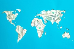 World map. Continents are laid out of dollars. Capitalism, consumer society concept