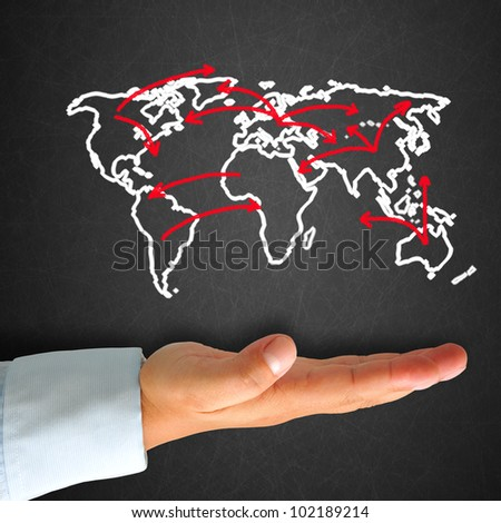 World map in blackboard with hand