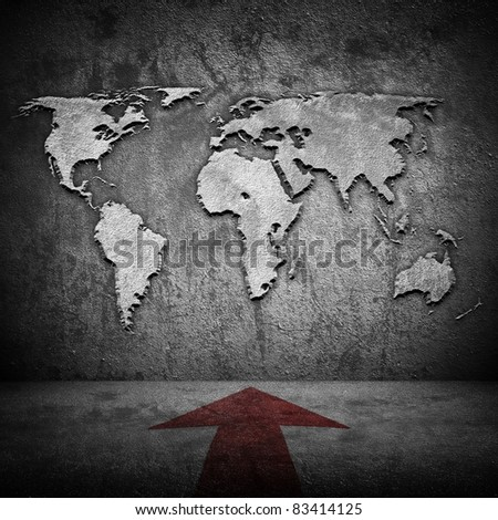 world map on wall with arrow on floor - stock photo