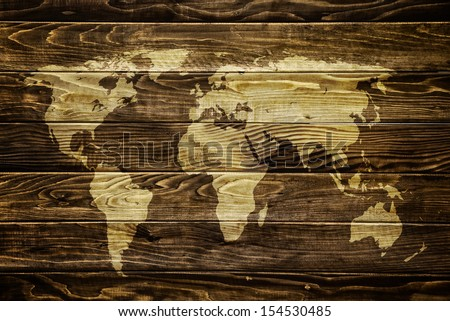 World map on wooden background. Traveling and tourism concept..