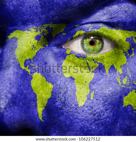 World map painted on face to show world support and awareness for the environment - stock photo