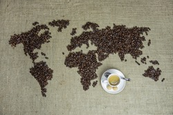 World map with coffee beans and a cup of coffee