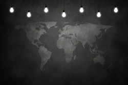 World maps on chalkboard in empty room with bulb lights lamp. Concept business, drawing, ideas