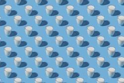 World Milk Day. Pattern on a blue background. A glass of milk. Pattern.