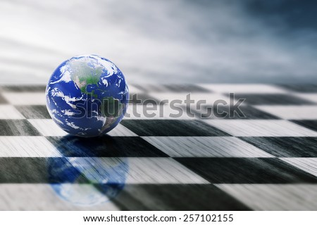 world on a chessboard isolated on blue sky background. Elements of this image furnished by NASA