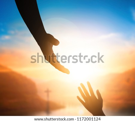 World Peace Day concept:Silhouette of Jesus reaching out hand