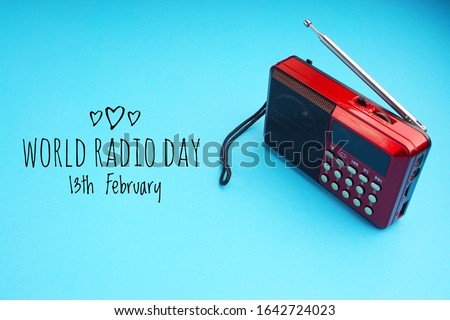 World Radio Day 13 February text with radio on blue background. Selective focus. Stock photo ©