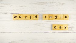 World Radio Day.words from wooden cubes with letters