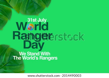WORLD RANGER DAY text and leaves on green background. WORLD RANGER DAY Concept Stock photo ©