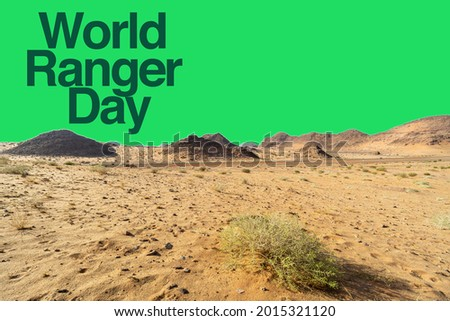 WORLD RANGER DAY text with double exposure concept of mountain desert on green background. Word Ranger Day Concept Stock photo ©