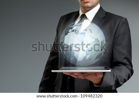 World technology communication concept. Globe from tablet pc. Touch pad interface collection.