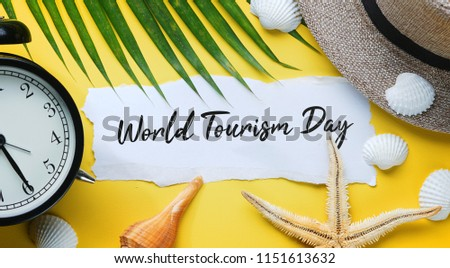 World Tourism Day Typography. Ripped Paper Between Flat Lay Summer Beach Accessories #1151613632