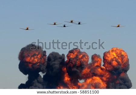 World War II era airplanes dropping bombs