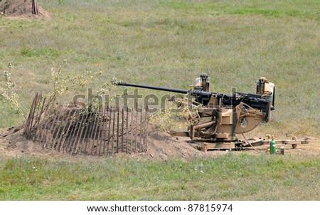 World War II era cannon on a battlefield