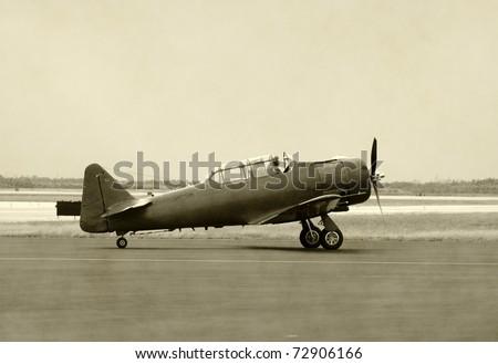 World War II era propeller airplane on the ground
