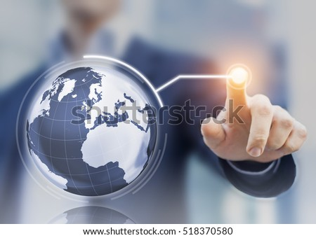 Worldwide business concept with 3D globe interface and businessman touching a button, global economy #518370580