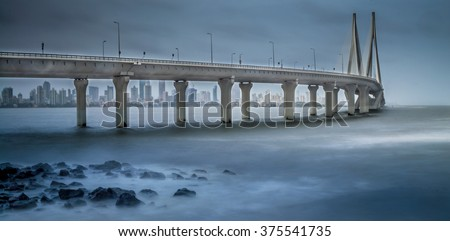Worli Sea Link in Mumbai during Monsoon with slow shutter speed to capture motion blur. Cropped to create a more panoramic effect