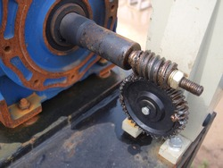 Worm gear or worm drive tramsission. From the electric motor driving the outdoor floodgates gear system. Focus close and choose the subject.