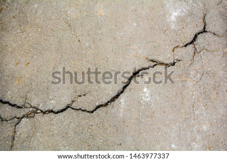 Worn and cracked asphalt with big cracks. Old road concrete texture with cracks #1463977337