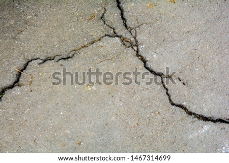 Worn and cracked asphalt with big cracks. Old road concrete texture with cracks #1467314699