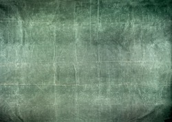 Worn and distressed army surplus green canvas tarp background