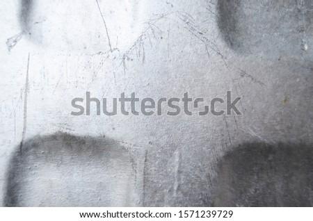 Worn and worn galvanized metal surface.
