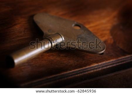 worn antique clock key