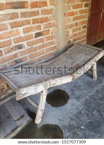 worn bamboo couches, crooked bamboo couches #1557077309
