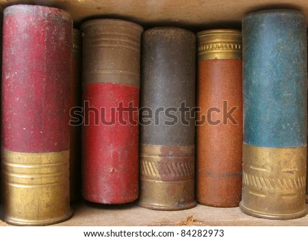Worn cardboard box of old and colorful shotgun shells. See all firearm-related photos from this collection at: http://www.shutterstock.com/sets/22007-guns.html?rid=70583