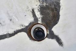 Worn condition drain hole in the bathroom, black rusted dirty bath