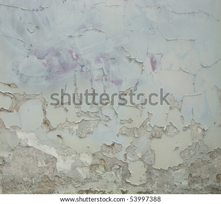 worn gray white light green painted wall with paint chip crack and blathering