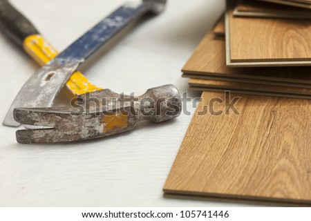 Worn Hammer and Pry Bar with Laminate Flooring Abstract.