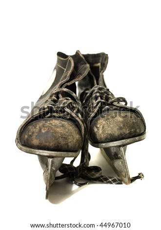 Worn ice-skates isolated on white background