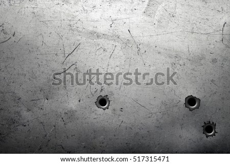 Worn metal background with bullet holes