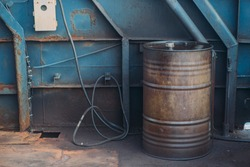 Worn metal barrel with fuel oil. Industrial background. .