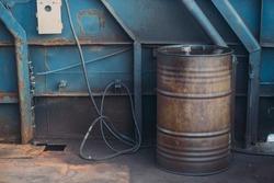 Worn metal barrel with fuel oil. Industrial background. .