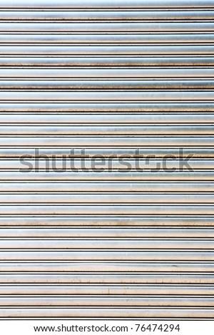 worn metal garage door gate store roller shutter