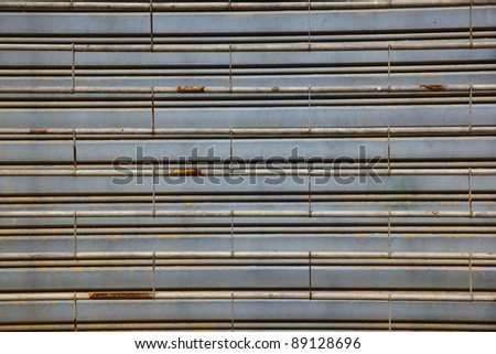 worn metal garage door gate,store roller shutter in Thailand