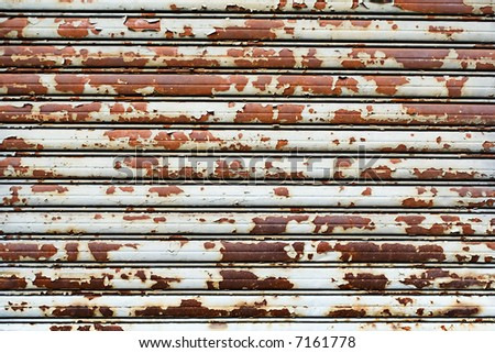 Worn Metal Panel Wall Store Front Section with Rust and Cracked and Peeling Paint, Texture Background Grunge, Horizontal