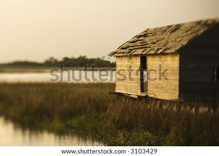 Worn out building in marsh at sunset on Bald Head Island, North Carolina.